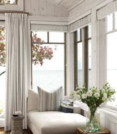 Relaxing beach house reading corner with lovely chaise and lots of windows...