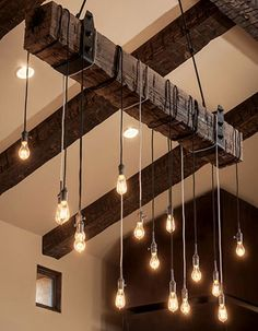 Create your own rustic industrial chandelier for your modern farmhouse lighting with a reclaimed wood beam! A wooden beam suspended from the ceiling around Farmhouse Lighting, Rustic Lighting, Lighting Design, Lighting Ideas, Unique Lighting, Outdoor Lighting, Garage Lighting, Interior Lighting, Home Lighting