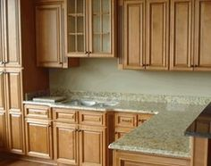 How to complement granite counters in this kitchen? - Houzz