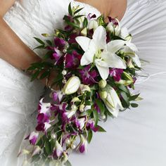 Purple and white cascade bouquet with lilies and orchids