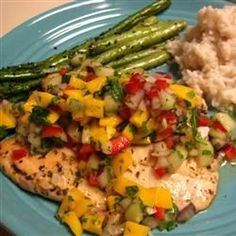 Grilled Tilapia with Mango Salsa:  this recipe is delicious, healthy and easy to make.