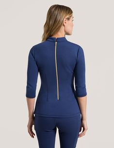 Mock Neck Top in Estate Navy Blue is a contemporary addition to women's medical scrub outfits. Shop Jaanuu for scrubs, lab coats and other medical apparel. Doctor White Coat, Dental Uniforms, Beauty Uniforms, Cute Scrubs, Scrubs Outfit, Greys Anatomy Scrubs, Moda Chic, Medical Scrubs, Nursing Clothes