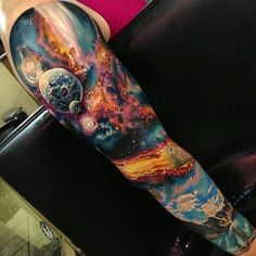 3D space full sleeve tattoo - Full sleeve tattoos are really great to look at especially when you've got a wonderful design. The colors of the universe plus the amazing scenes that happens in space is surely a design worthy of a full sleeve.