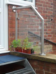 Small glass balustrade to patio steps.