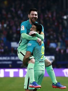 Lionel Messi (L) of FC Barcelona celebrates scoring their second goal with teammate Luis Suarez (R) a during the Copa del Rey semi-final first leg match between Club Atletico de Madrid and FC Barcelona at Estadio Vicente Calderon on February 1, 2017 in Madrid, Spain.
