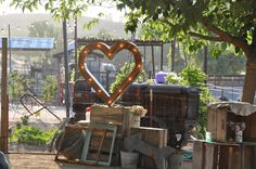 Your friends and family will love taking photos with this heart marquee and wood crate photobooth. #Peltzerwineryandfarm, #peltzerwedding, #temeculawedding #photobooth