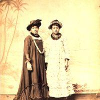 Studio portrait - women dressed in hats, muumuu, and lei. Late 1880s.