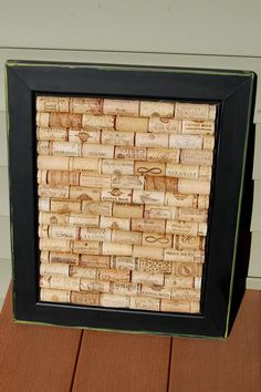 Wine Cork Board.    from:  http://www.etsy.com/listing/95942935/wine-lover-upcycled-black-framed-wine