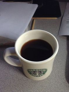 My. Coffee, my Starbucks mug with Italian coffee; much better!