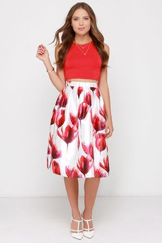 Step into the Fragrance of Flowers Ivory and Red Floral Print Midi Skirt and instantly transform into your own beautiful botanical garden! Silky woven ivory fabric is adorned with a painterly red, fuchsia, and yellow floral print, creating a high waist with a hidden zipper at back. The full and structured skirt flows down to a chic and pleated midi length. Lined to mid-thigh. 100% Dacron. Hand Wash Cold.