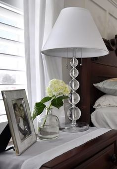 Beautiful and simple vignette on bedside table.