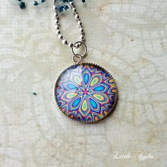 New to LittleApples on Etsy: Kaleidoscope necklace mandala charm glass pattern abstract jewelry blue yellow (10.00 USD)