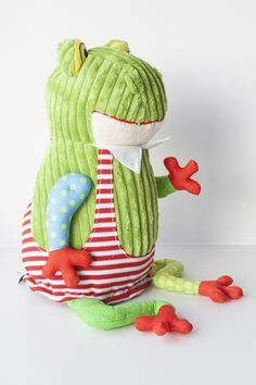 Original Deglingos are French-designed funky plush toys with their own quirky language. Made from a super soft thick corduroy, jute fabric, and a patchwork of hip patterns, they are perfect as a companion for all ages or for decorating.