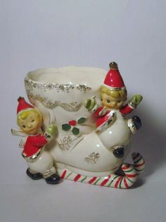 Items similar to Vintage Christmas Pixie Elf Napco Candy Cane Sleigh Santa Claus Planter Holder Figurine porcelain ceramic Japan Ornament Decoration on Etsy Christmas Items, Christmas And New Year, Merry Christmas, Rustic Christmas, Christmas Holidays, Xmas, Christmas Figurines, Christmas Ornaments, Retro Christmas Decorations