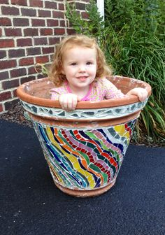 After a year the mosaic pot is finished and ready to grow some cute little girls.