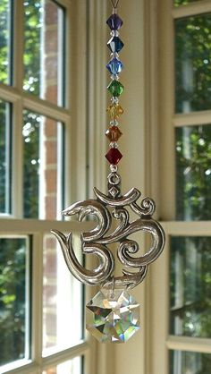 """Crystal Sun Catcher with Pewter OM, Yoga Studio Decor, Swarovski Crystal Strand and Pendant, Chakra Colors, Suncatcher for Car or Home """"Om"""" Feng Shui, Suncatchers, Yoga Studio Decor, Chakra Colors, Hanging Crystals, Wind Spinners, Swarovski Crystal Beads, Mobiles, Wind Chimes"""