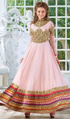 Be your exceptional vogue diva with this long Anarkali suit in pink color shade georgette. The incredible dress creates a dramatic canvas with superb lace, resham and stones work. #gloriousdesignanarkalidresses #anarkalidresses #longflaredanarkalisuits