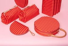Coral and red striped leather Mansur Gavriel half-moon clutches, doctor's bag, top-handled briefcase-style purses, and fold over clutch.