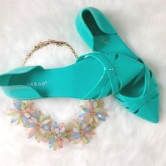 Turquoise Jelly Flats Perky pointed toes, d'orsay heel, some wear to soles but uppers in good shape! Add a little whimsy to your warm weather look! Bamboo Shoes Flats & Loafers