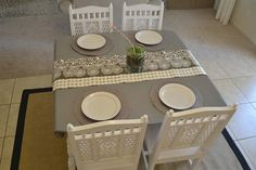 Slate stained table with white chairs....maybe I'll do this and my chairs can be white (backrest) and gray.     Sweetie Pie Style: Dining Table Before & After: How to Refinish A Wood Table