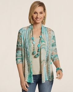 Paisleys and leaves swirl across the featherlight cardigan. Layer on the colorful creation anytime of year.
