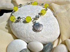 Scallop shell bracelet, citrine. . . inspire friends or family to have a positive outlook on life. Features the concha shell of the Camino de Santiago for life's journey. But the shell is also representative of the Goddess of Love, Aphrodite - and so perhaps, with this lovely charm bracelet, anything is possible in the world of romance too.