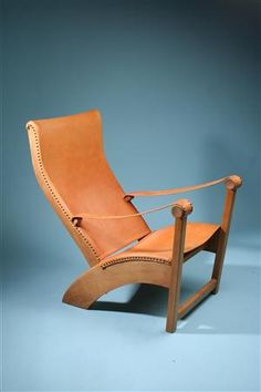 Copenhagen. Designed by M. Voltelen for Rud Rasmussen, Denmark. 1930's.    Oak and natural leather