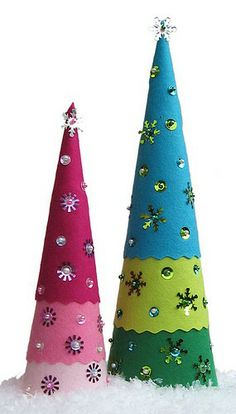 Merry & Bright Christmas Inspiration Felt trees are a great DIY project to make with the kids, simply felt wrapped around a cone shape and embellish with brads, crystals, buttons....
