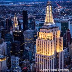 """Photograph by George Steinmetz #geosteinmetz / #newyorkairbook  When he was little, my son Nicky used to call it the """"Entire State Building"""", after I told him that it was once the tallest building in the entire state. Nicky has grown up now, and the city is going through a building boom of its own. Although the big E's altitude record has been broken a several times, the observation decks still have spectacular views."""
