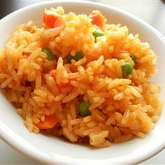 ***Quick and Easy Spanish Rice - 0.25 C onion, 2 garlic cloves, 2 T oil, 3 C uncooked instant rice, 2.25 C chicken broth, 1 C veg juice (V8), 1.5 teas taco seasoning - made 10/11 - tasty