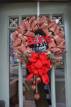 Add a pop of red to a DIY burlap Christmas Wreath for a totally different look. Adorn with a red Christmas bow and some bells for your own unique Christmas wreath