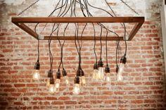 Make It: A DIY Hanging Light Bulb Chandelier! Part rustic, part industrial, part awesome! With a few basic hardware store supplies, this DIY chandelier is a cinch to… Continue Reading Light Bulb Chandelier, Hanging Light Bulbs, Chandelier Lighting, Chandelier Ideas, Hanging Chandelier, Iron Chandeliers, Cafe Industrial, Industrial Lighting, Industrial Furniture