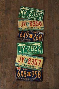 vintage license plates as wall decor - I need to do this with our old plates!
