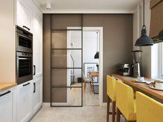 Porta e vidro estilo industrial, divide os ambientes da cozinha e sala de estar.