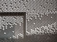 Bent by Chris Kabel. Punched tabs on aluminum facade can be bent up to catch light, down to create shadow, creating customizable pattern.