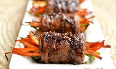 PTR Balsamic Glazed Steak Rolls: marinated skirt steak wrapped around lovely vegetables topped with a balsamic glaze Meat Recipes, Paleo Recipes, Cooking Recipes, Paleo Food, Recipes Dinner, Delicious Recipes, Healthy Food, Recipies, Balsamic Glaze