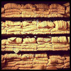 Aran sweaters stacked at the Aran Sweater Market on Inis Mor, Aran Islands