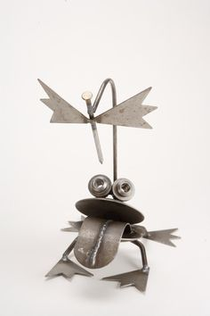 Frog with Fly Metal Statue - A frog has been waiting patiently for his next meal. This beautiful sculpture depicts a frog sitting quietly waiting for his next victim. A fun and whimsical piece made from steel. Each peaceful vary slightly due to the handmade nature.