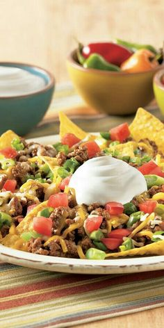 Dad's Nachos  1 LBS Browned Ground Beef 1 Packet Taco Seasoning  1 Can Nacho Cheese Soup 1/4 Cup Milk Add Other Cheeses You Like Mix All Together   EXTRA INGREDIENTS :  Sour Cream, Salsa, Lettuce, Tomatoes, Jalapeños, Chili Beans, Green Chilies,  Don't Forget Tortilla Chips