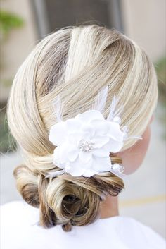 I really love this flower in the hair. Maybe with that other side bun hair do?  Have to be spring/summer. http://fuupon.com/