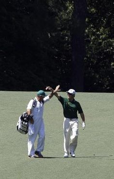"Sunday at The Masters: Oosthuizen and his caddie ""miss"" their high five"