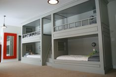 love these built in bunk beds...painted grey...light fixtures...separate nooks for personalization and storage