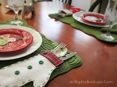 Easy Table Decorations Are you hosting a holiday party at your house? If so, I have a fun and easy way to dress up the table. All you need is some felt, scissors, hot glue, and some cute embellishments like ribbons or buttons. What are we making? Silverware holders!