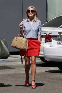 Reese nailed the casual preppy look by opting for a simple blue button down and vibrant red skirt.