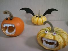 Cute little bat and vampire pumpkins using pushpins and kids costume teeth. What a great idea!
