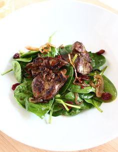 If you like chicken liver, this salad is absolutely delicious. The key is to get really good chicken livers, then sauté them initially at high heat to get a slightly crispy outside. You'll have a slight crunch on the outside with a creamy center, and it's a really unctuous addition to your spinach salad.