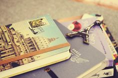 journals.. can't go wrong with a postcard covered journal