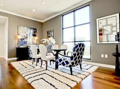 Idea for dining room. Already have grey walls, white trim, black table and textured head chairs. White side chairs?