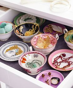 Thrift store bowls and plates to hold jewelry in a drawer.