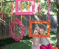 Photo Booth photo booth theme. love this! Paint frames hot pink, lemon yellow, and/or green. I love that they are hanging and people stand behind them.